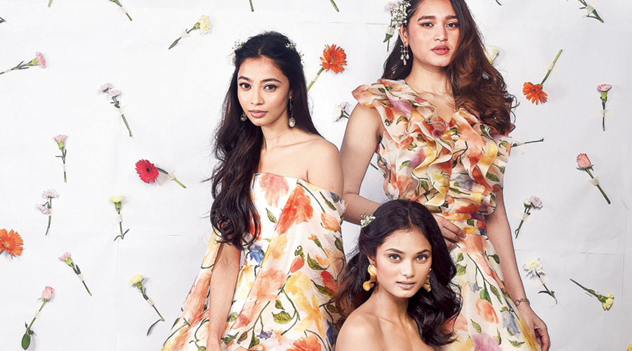 """Pretty and feminine, this frame looks like one happy painting. The print has a """"watercolour effect"""" and the organza adds a """"princess-y feeling"""". Neha gave Juhie Ghosh a skirt and top, Diti Saha a slit gown and Anushka Laha, a midi dress. Ruffles were a hit in Neha's inaugural collection and she wanted to play around with the same in A Summer Song too."""