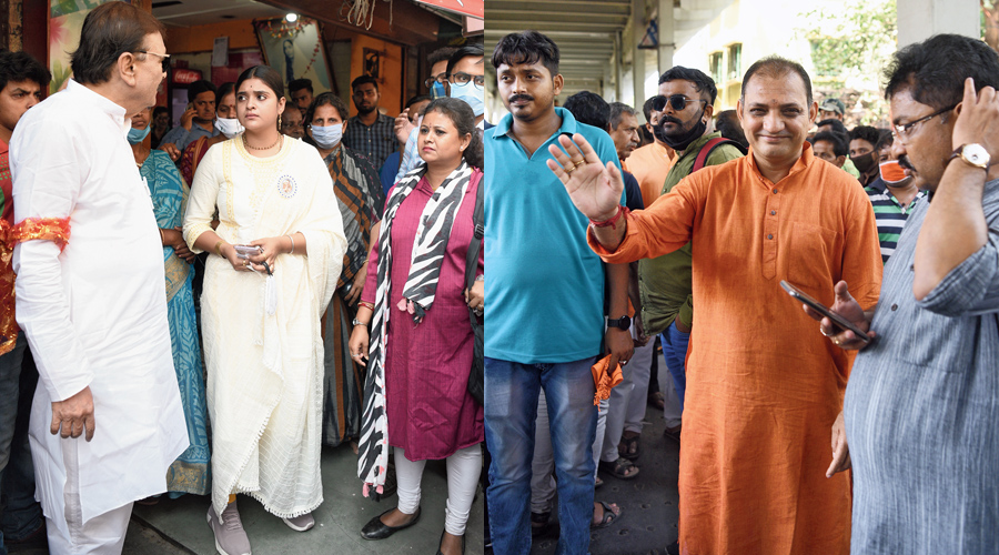 Trinamul's Madan Mitra and (right) the BJP's Raju Banerjee campaign in Dakshineswar on Wednesday.