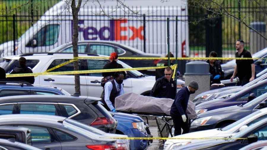 A body is transported from a Fedex facility in Indianapolis on Friday, April 16, 2021, where a mass shooting occurred Thursday night.