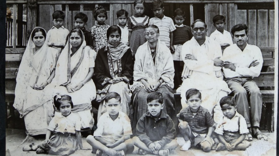 Rabindranath Bisharad (second from right) in front of Rilbong L.P. School, Shillong, along with other teachers and students