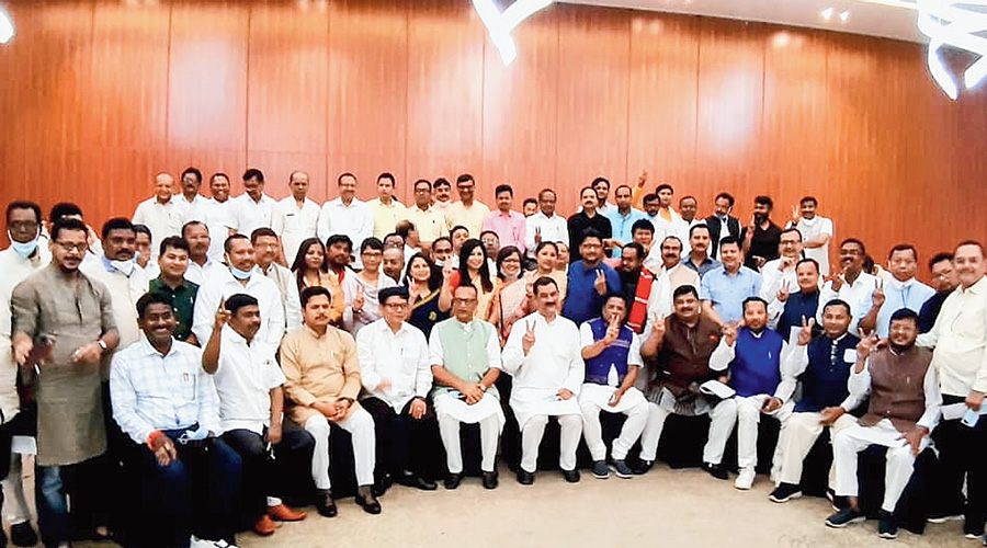 Congress Assembly poll candidates and senior leaders pose for a group photo after their meeting at a resort near the airport in Guwahati on Saturday.