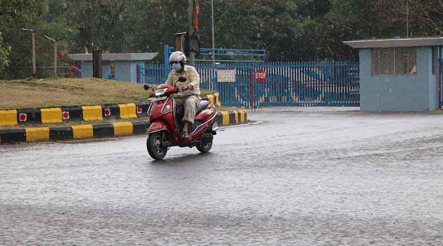A commuters caught in a sudden shower at Sakchi in Jamshedpur on Sunday.