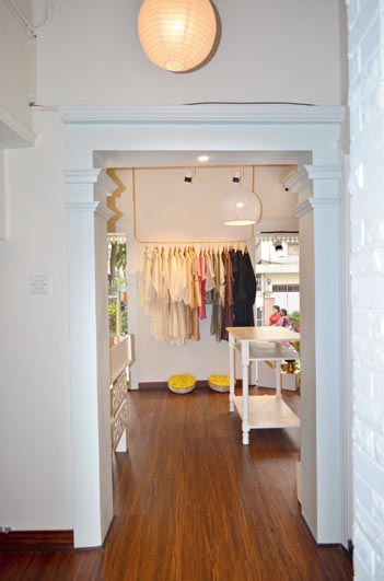 Done up in white with touches of subtle gold, the store spells calm, peace and elegance. Minimalist design has been maintained throughout, with even the lights matching the ivory decor.