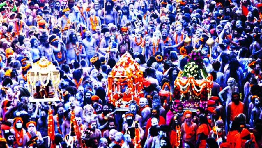 Devotees gather to offer prayers during the third 'Shahi Snan' of the Kumbh Mela 2021, at Har ki Pauri Ghat in Haridwar, Wednesday, April 14, 2021.