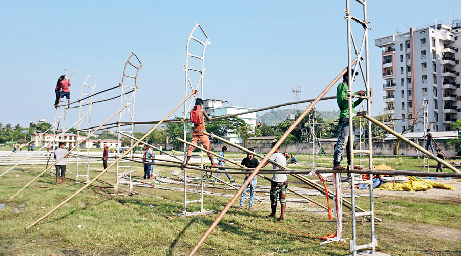 Workers construct a Covid care centre at Sarusujai Stadium in Guwahati on Monday.