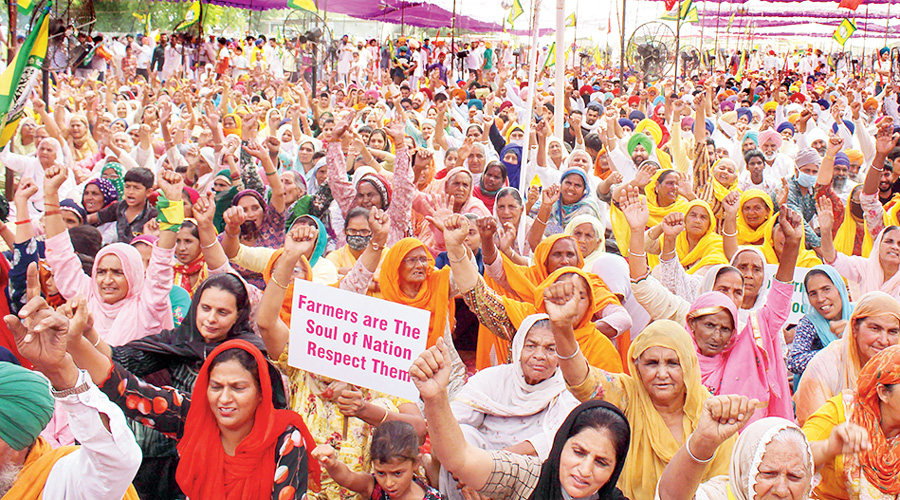 Farmers stage a protest on the outskirts of Amritsar on Monday.