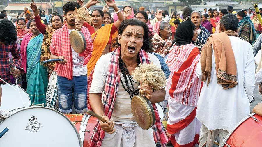 A Matua devotee dances at a religious programme.