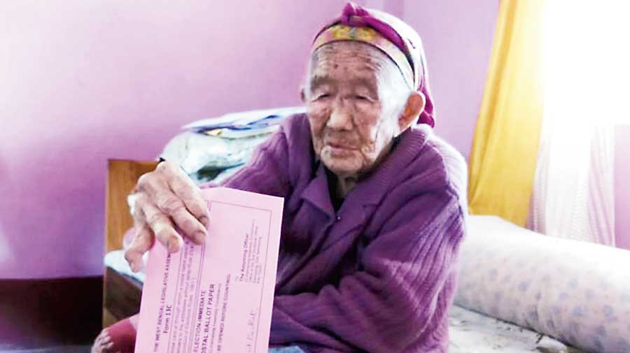 An elderly woman votes at her home in Kalimpong. The anonymous poll official did not visit this area