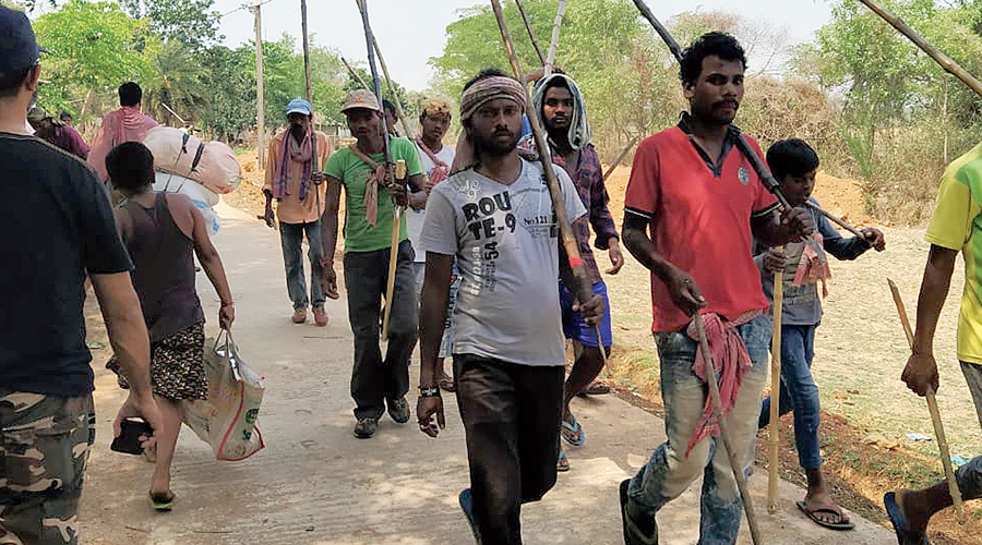 Hunters walk towards a forest in  West Midnapore on Wednesday.