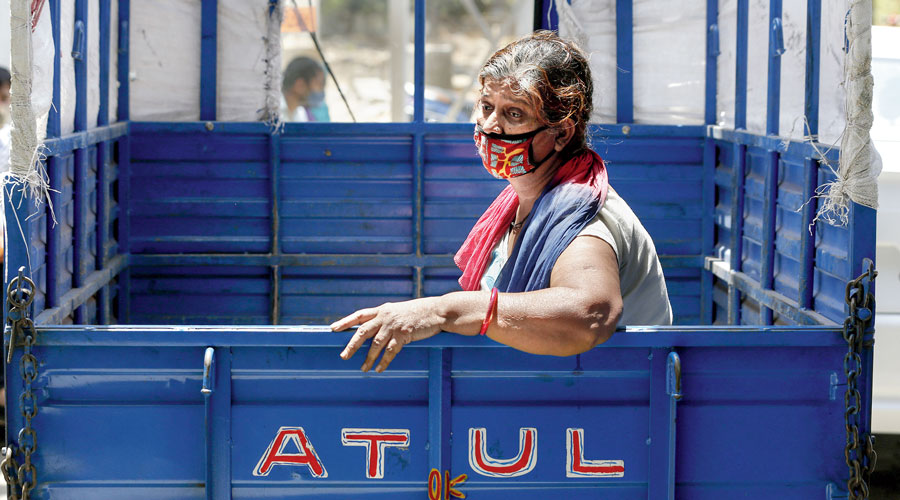 Distress writ large on the face of a Covid patient who waits in a tempo for admission to an Ahmedabad hospital.