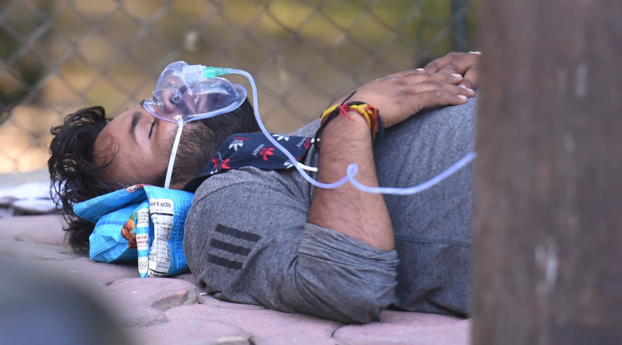 A Covid-19 patient receives free oxygen, provided by a Sikh organization at Indirapuram Gurudwara, in Ghaziabad on Saturday.