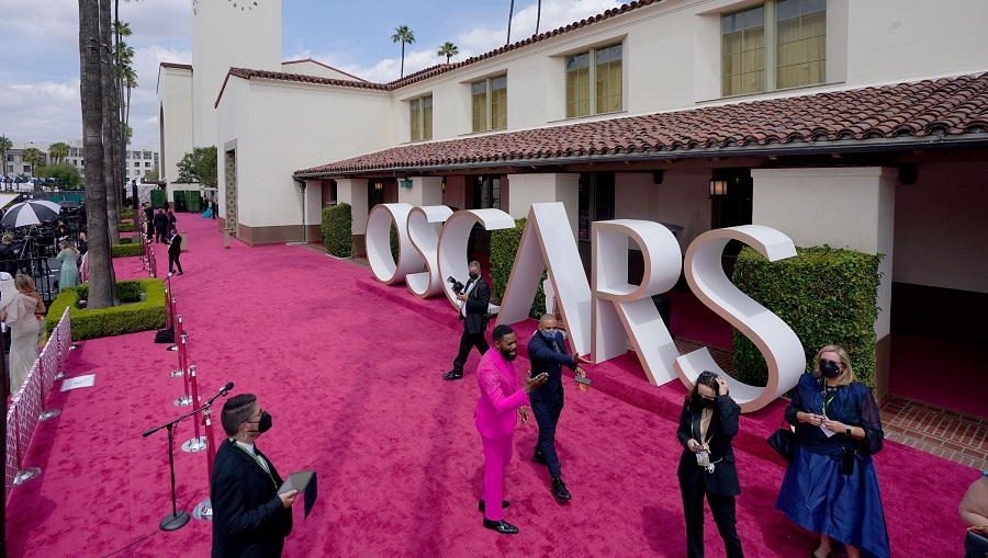 "Colman Domingo, in pink, a star of ""Ma Rainey's Black Bottom,"" arrives before the 93rd Academy Awards at Union Station in Los Angeles, April 25, 2021."