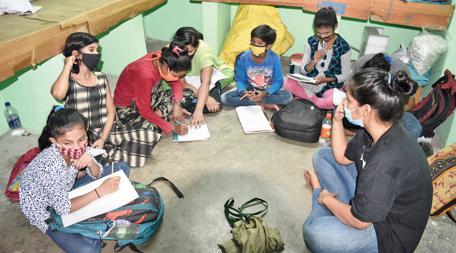 Taishi Nandi takes a class at the school on the Jadavpur University campus.