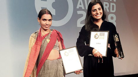 In February 2018, Bimla Devi (left), a weaver-turned-designer with Jaipur Rugs, journeyed from rural Rajasthan to Frankfurt, Germany to receive the prestigious German Design Award for her rug, Kamal, along with Kavita Chaudhary, design director, Jaipur Rugs. Going from Aaspura, Rajasthan to Frankfurt, Bimla Devi walked on stage to collect the award. Jaipur Rugs achieved this feat, competing with over 5,000 applicants from 56 countries, 40+ Gold award categories and 45 gold award winners, joining brands such as Audi, Porsche, Samsung and Puma.