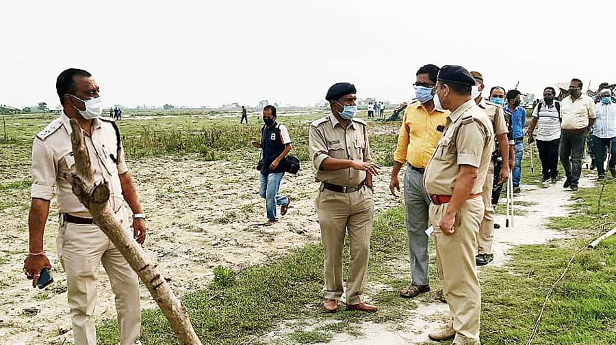 Police officers at the demolition spot in Jalpaiguri.