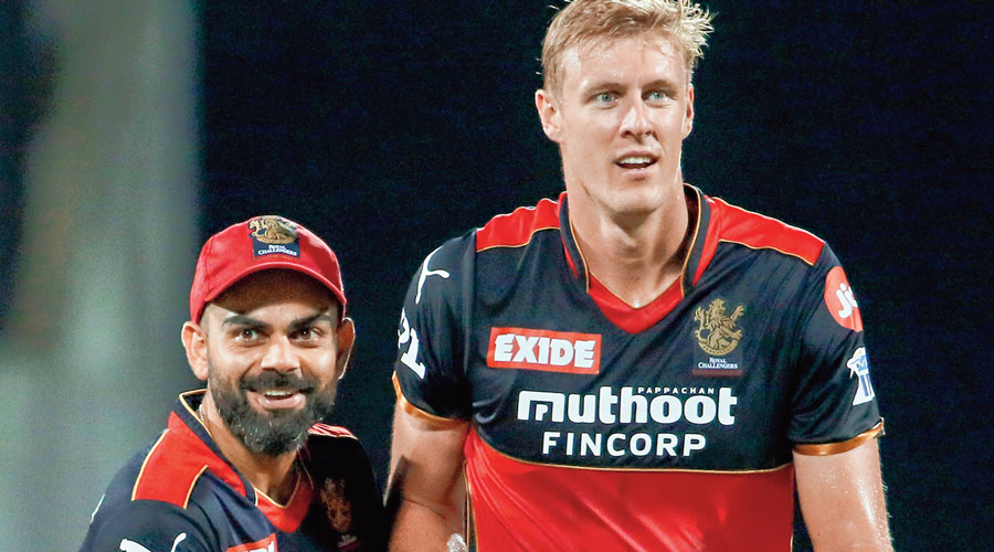 Virat Kohli and (right) Kyle Jamieson in RCB colours