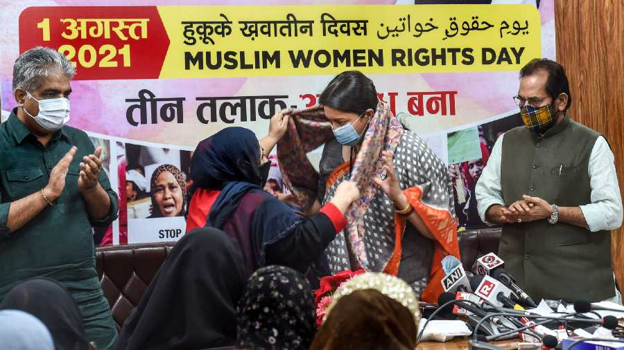 Union Ministers Smriti Irani, Bhupender Yadav (L) and Mukhtar Abbas Naqvi (R) during the Muslim Women Rights Day, in New Delhi, Sunday