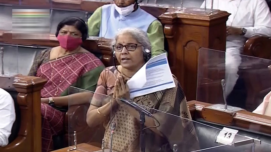 Union Finance Minister Nirmala Sitharaman speaks in the Lok Sabha during the Monsoon Session of Parliament, in New Delhi, Tuesday, August 3, 2021.