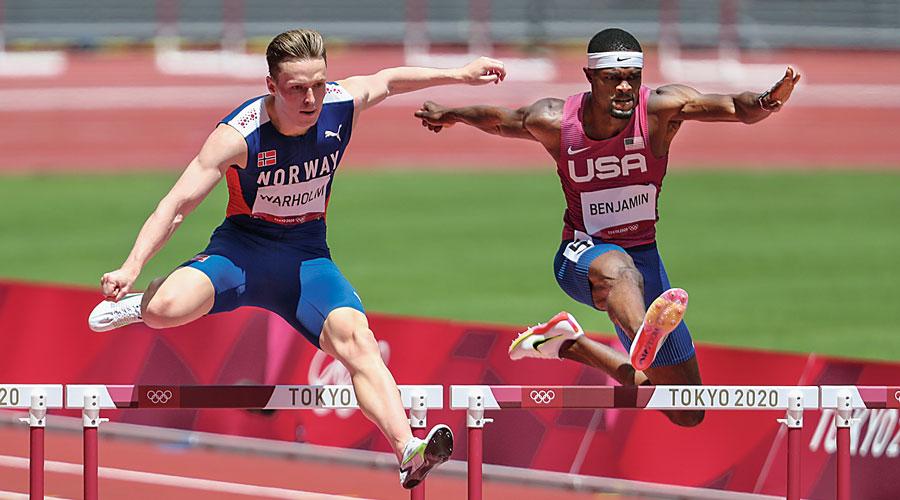 Karsten Warholm (left) and Rai Benjamin during the men's 400m hurdles.