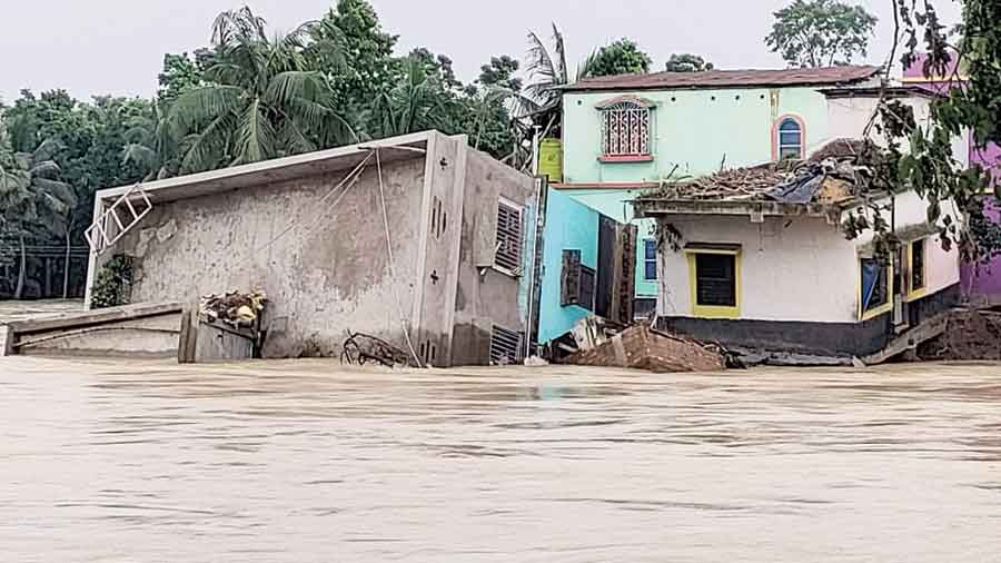 A two-storey house, which went under water at the flooded-Bandar village near Khanakul in Hooghly district three days ago, completely collapsed on early Tuesday morning.