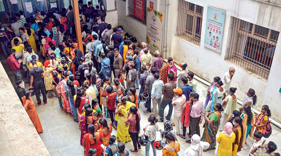 Beneficiaries wait in queues to receive the Covid-19 vaccine dose at Sadar  hospital in Ranchi on  Friday.