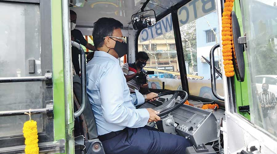 Transport minister Firhad Hakim at the trial run of the CNG buses on Monday.