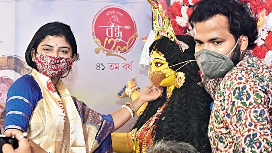 Rajarhat Gopalpur MLA Aditi Munshi poses with the masked goddess at the club's khuti puja on Sunday.