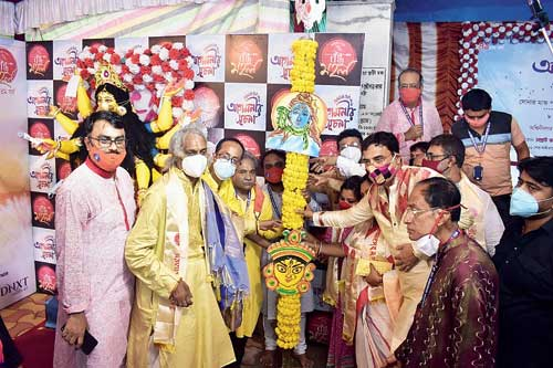 Jayanta Kushary, chief priest of the Sovabazar Rajbari puja, (second from left) with club members at the khuti puja