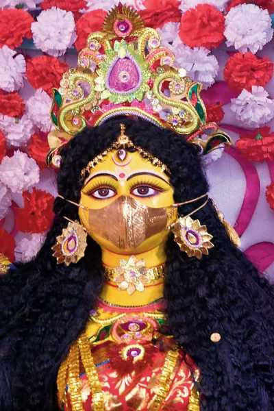 The 6ft clay idol of the goddess with the gold mask on at the Ashwininagar Bandhu Mahal puja in Baguiati.