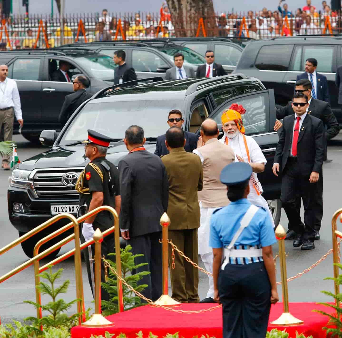 Rajnath Singh greets Narendra Modi as he arrives at the Red Fort on Sunday.