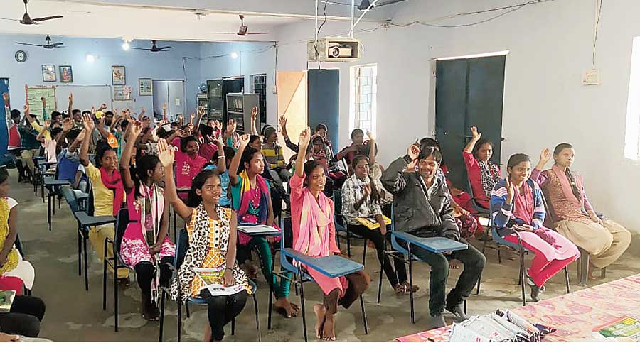 Rural students at an interactive session at a digital library set up in an unused government school classroom at Kharsawan in Jharkhand