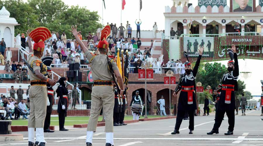 Border Security Force personnel and Pakistani Rangers during the Beating Retreat border ceremony on the occasion of 75th Independence Day, at the Attari-Wagha border