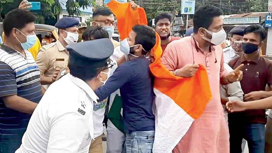 Policemen intercept BJP supporters at Hashmi Chowk in Siliguri on Tuesday.