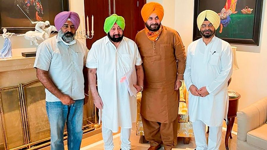 Amarinder Singh, Navjot Sidhru with other Congress members on Friday.