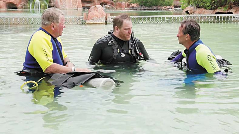 Josh Gates with William Shatner (left) in Expedition Unknown: Shark Trek