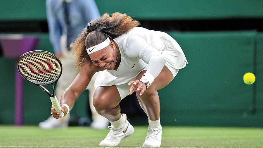 Serena Williams winces in pain during her first-round match against Aliaksandra Sasnovich at Wimbledon in June. She has not played on tour since retiring in the first set of that match.