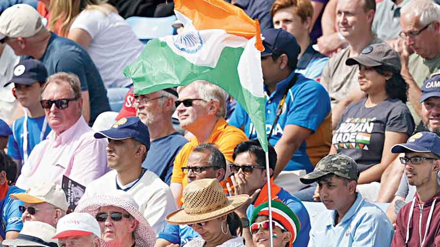 A  young fan waves an Indian flag during the first day of third test cricket match between England and India, at Headingley cricket ground in Leeds, England, Wednesday, Aug. 25, 2021.