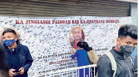 People take part in the signature campaign at Mawlai in Shillong on Friday seeking justice for the encounter death of Cheristerfield Thangkhiew
