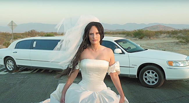 Instead of going into a self-pity mode wearing a wedding dress, Kacey Musgraves takes control of her narrative in the film that comes with her forthcoming album, Star-Crossed