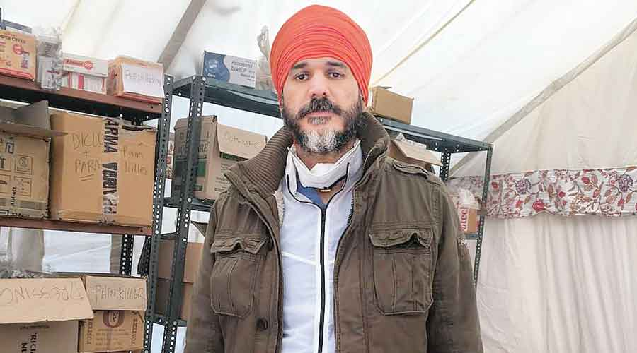 "Dr Swaiman Singh at his camp named ""Pind California"" at the Tikri protest site"