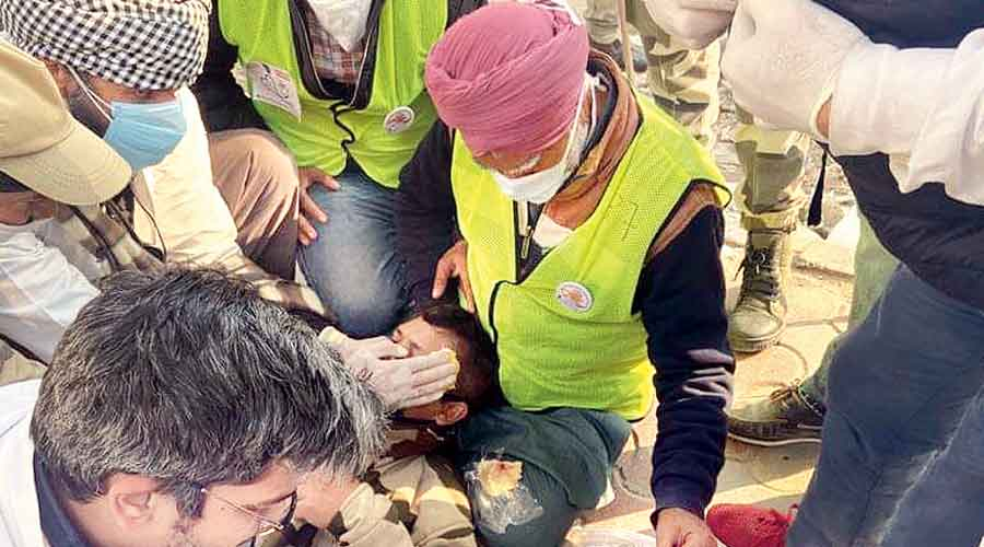 Volunteers give first aid to a CISF jawan at Nangloi in west Delhi on Republic Day