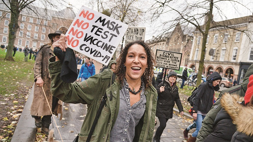 Protesters march during the anti-lockdown protest on November 14, 2020 in Bristol, England. Police had warned protesters to cancel the march or face possible fines.