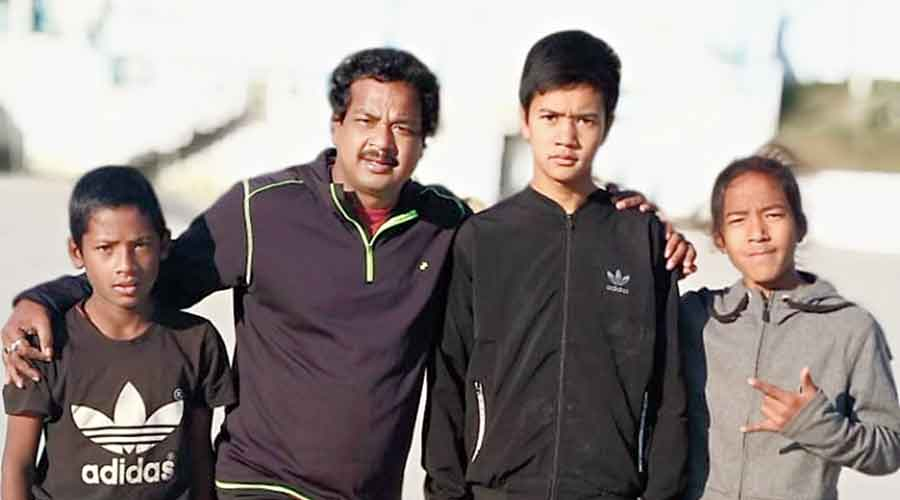 Pabitra Sarkar with some young players in Jalpaiguri