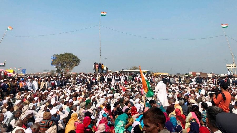 Farmers block a highway in Palwal, Haryana, during there three-hour long 'chakka jam' on Saturday against the Centre's three new farm laws.