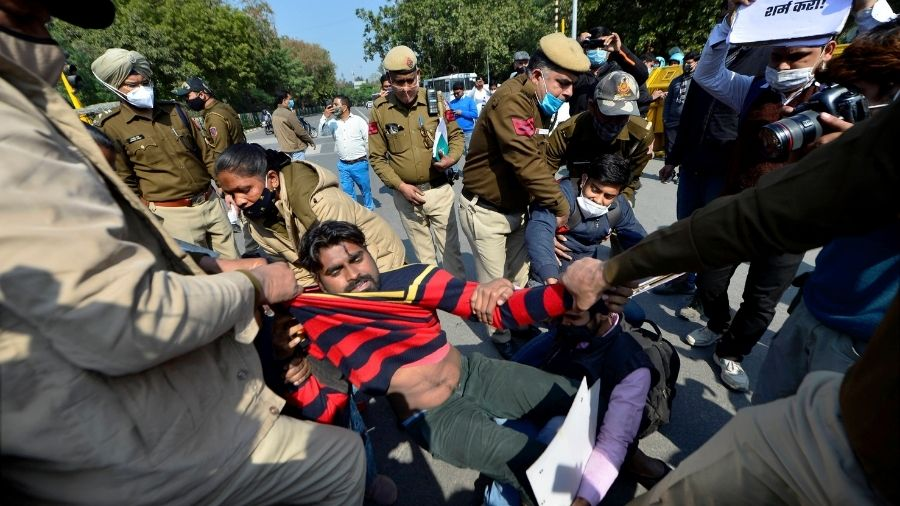 Police detain left-wing activists protesting during farmers' 'chakka jam' movement, at Shaheed Park in New Delhi, on Saturday.
