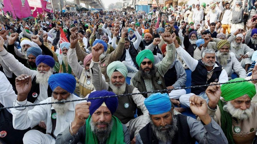 Farmers demonstrate at the Tikri border on Saturday.