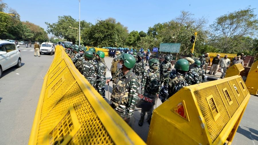 Police and security personnel stand guard at the national capital. Security has been tightened in Delhi after the break out of clashes during farmers' tractor rally on January 26.