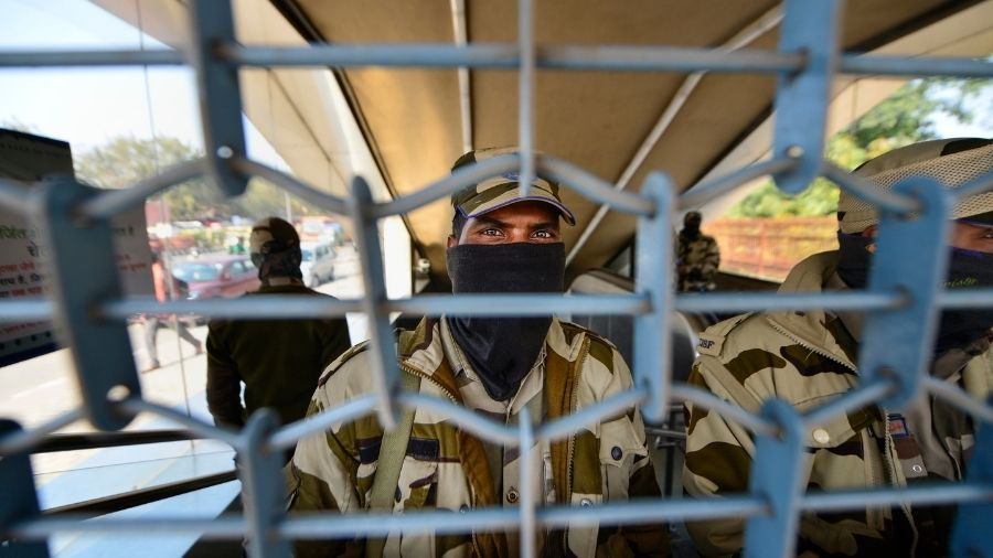 Security personnel guard the Lal Quila Metro Station in New Delhi, which was closed during Saturday's protest, owing to the violence that broke out at Red Fort on January 26.