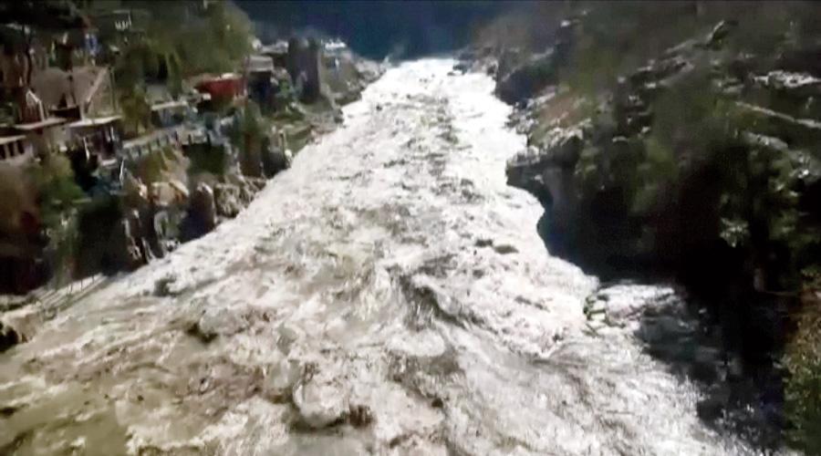 Footage shows the flood in Chamoli, Uttarakhand, on Saturday.