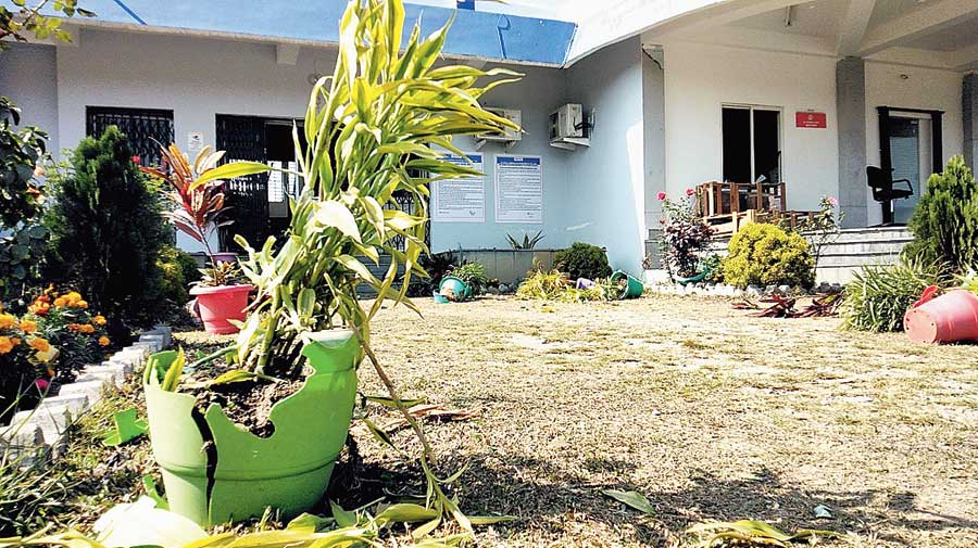 Broken flowerpots on Thursday outside one of the offices of the inland container depot near New Jalpaiguri station